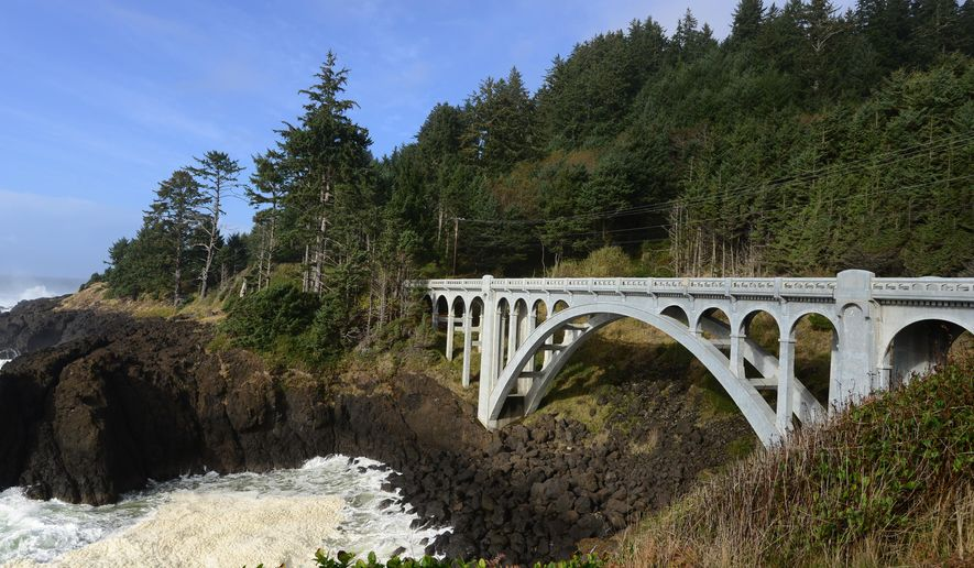 ADVANCE FOR WEEKEND EDITIONS, NOV. 1-2 - This photo taken on Oct. 15, 2014, shows the scenic Rocky Creek Bridge, also known as the Ben Jones Bridge, at the Cape Foulweather area near Depoe Bay, Ore. (AP Photo/Statesman-Journal, Danielle Peterson)