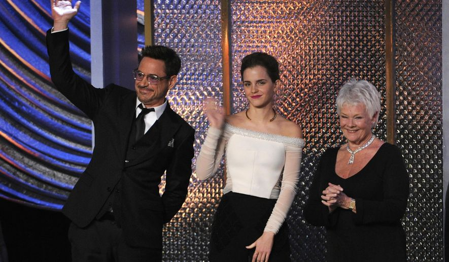 Honorees Robert Downey Jr., from left, Emma Watson and Judi Dench appear on stage at the BAFTA Los Angeles Britannia Awards at the Beverly Hilton Hotel on Thursday, Oct. 30, 2014, in Beverly Hills, Calif. (Photo by Chris Pizzello/Invision/AP)