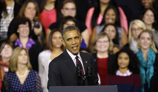 President Barack Obama speaks about the economy after participating in a roundtable discussion with working parents, small business owners, students and faculty, Friday, Oct. 31, 2014, at Rhode Island College in Providence, R.I. Obama wants women to know what his administration is doing to help them succeed. (AP Photo/Stephan Savoia)