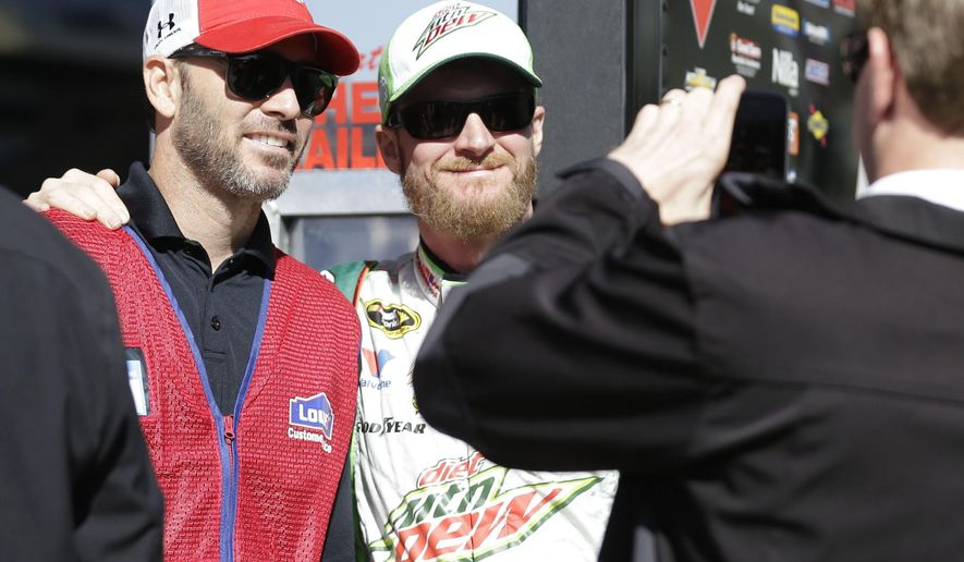 Sprint Cup Series drivers Dale Earnhardt Jr., second from left, and Jimmie Johnson pose for a photo before practice at Texas Motor Speedway in Fort Worth, Texas,  Friday, Oct. 31, 2014. Drivers are preparing for the the Texas 500 auto race that is to run Sunday. (AP Photo/LM Otero)