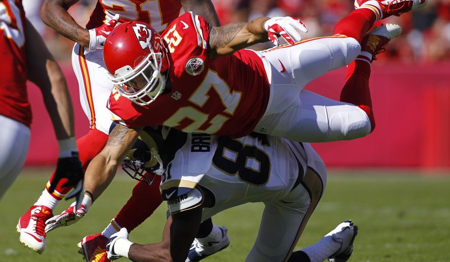 Kansas City Chiefs defensive back Kurt Coleman (27) breaks up a pass intended for St. Louis Rams wide receiver Kenny Britt (81), with Kansas City Chiefs cornerback Sean Smith (21) and inside linebacker Josh Mauga (90) join in, in the second half of an NFL football game in Kansas City, Mo., Sunday, Oct. 26, 2014. (AP Photo/Colin E. Braley)