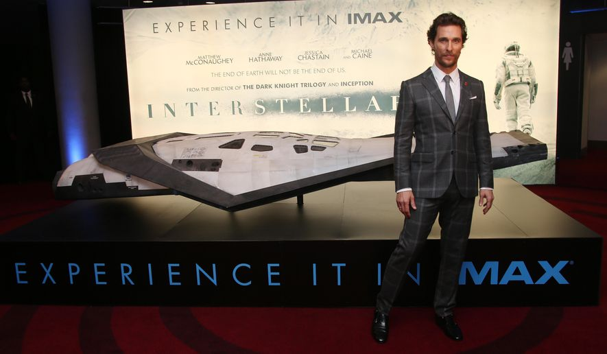 """FILE--In this Wednesday, Oct. 29, 2014 file photo, actor Matthew McConaughey poses for photographers upon arrival at the premiere of the film """"Interstellar,"""" in central London. In the sci-fi extravaganza out Nov. 5, 2014, a particularly acerbic robot named TARS (portrayed by Bill Irwin) accompanies a team of astronauts led by McConaughey's pilot Cooper to find humankind a new home after an ecological disaster wrecks earth. """"If anything, he's the one Cooper gets along with the most out of anyone up there,"""" said McConaughey. (Photo by Joel Ryan/Invision/AP, File)"""