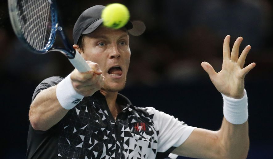 Tomas Berdych of the Czech Republic, returns the ball to Kevin Anderson of South Africa during their quarterfinal match at the ATP World Tour Masters tennis tournament at Bercy stadium in Paris, France, Friday, Oct. 31, 2014. (AP Photo/Michel Euler)