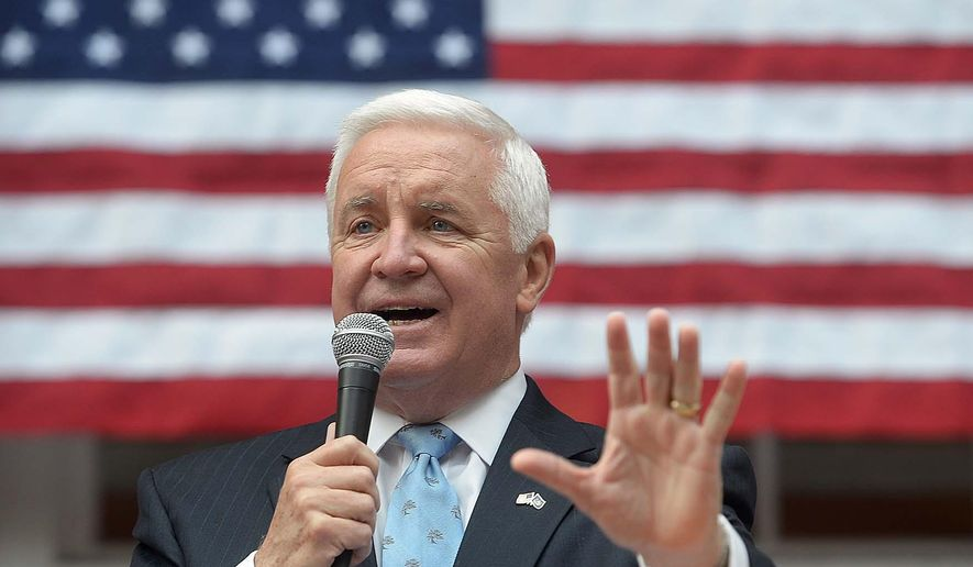 Pennsylvania Gov. Tom Corbett addresses the crowd at the Old Courthouse in Carlisle, Pa. Friday, Oct. 31, 2014, during a stop on his re-election campaign tour. (AP Photo/The Sentinel, Jason Malmont)