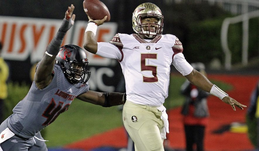 Florida State quarterback Jameis Winston (5) gets off a pass despite the efforts of Louisville defensive end Delontrez Mount (48) in the second half of their NCAA college football game in Louisville, Ky., Thursday, Oct. 30, 2014. Winston led No. 2 Florida State to a 42-31 come-from-behind victory over Louisville. (AP Photo/Garry Jones)
