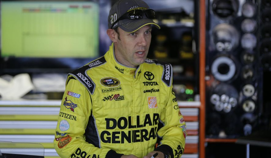 Sprint Cup Series driver Matt Kenseth walks walks in the garage during practice at Texas Motor Speedway in Fort Worth, Texas,  Friday, Oct. 31, 2014. Kenseth says he feels terrible about the wreck that left Kevin Harvick last among the eight drivers still eligible in NASCAR's Chase for the Sprint Cup championship. (AP Photo/LM Otero)
