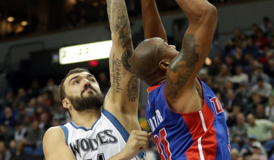 Detroit Pistons' Caron Butler, right, shoots as Minnesota Timberwolves' Nikola Pekovic of Montenegro defends in the second half of an NBA basketball game, Thursday, Oct. 30, 2014, in Minneapolis. The Timberwolves won 97-91. Butler led the Pistons with 24 points and Pekovic had 10 rebounds and scored 17 points. (AP Photo/Jim Mone)
