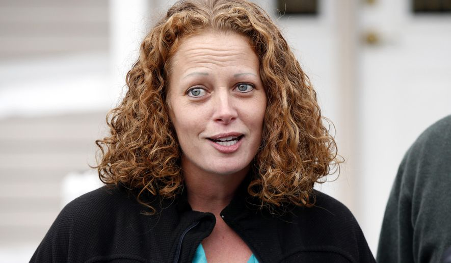 Nurse Kaci Hickox speaks to reporters outside their home, Friday, Oct. 31, 2014, in Fort Kent, Maine. A Maine judge gave Hickox the OK to go wherever she pleases, handing state officials a defeat Friday in their bid to restrict her movements as a precaution against Ebola.( AP Photo/Robert F. Bukaty)