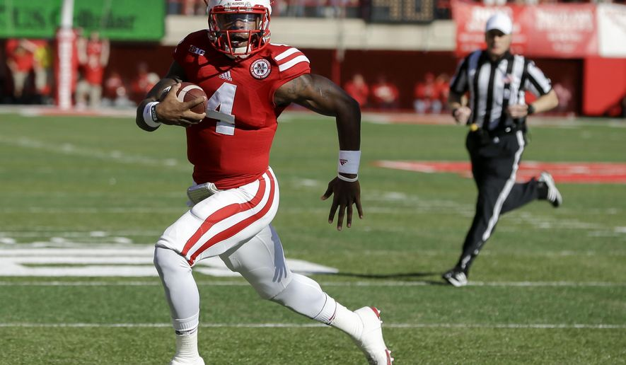 Nebraska quarterback Tommy Armstrong Jr. (4) runs for a touchdown in the first half of an NCAA college football game against Rutgers in Lincoln, Neb., Saturday, Oct. 25, 2014. (AP Photo/Nati Harnik)