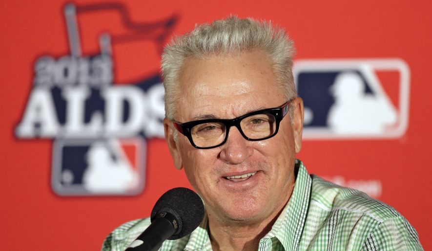 FILE - In this Oct. 6, 2013, file photo, Tampa Bay Rays manager Joe Maddon smiles during a news conference before Game 3 of baseball's American League division series against the Boston Red Sox in St. Petersburg, Fla. The Chicago Cubs have fired manager Rick Renteria after one season to pursue former Tampa Bay manager Joe Maddon. Team President Theo Epstein said Friday, Oct. 31, 2014,  that Renteria deserved to come back next season as the Cubs continue their rebuilding effort. But Maddon opted out of his contract with the Rays and Epstein says that changed things for the Cubs.(AP Photo/Chris O'Meara, File)