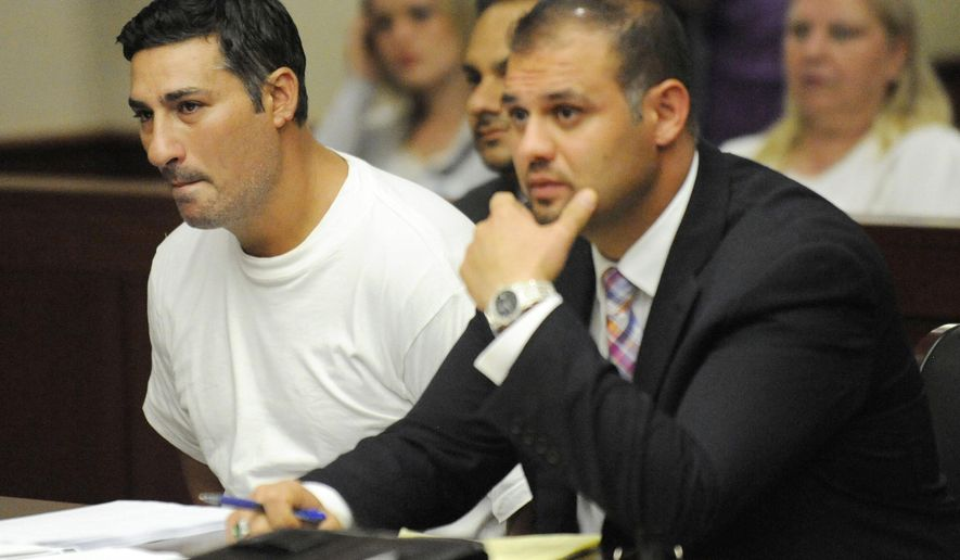FILE- In this July 10, 2014 file photo, Bassel Abdul Saad, left, sits with his attorney Ali Hammoud, during his arraignment before Judge Kathleen McCann in the 16th District Court in Livonia, Mich.  Saad is accused of killing John Bieniewicz, a referee, with a punch to the neck.  A hearing for Saad is scheduled in Wayne County Circuit Court on Friday, Oct. 31. (AP Photo/Detroit News, David Coates)  MANDATORY CREDIT