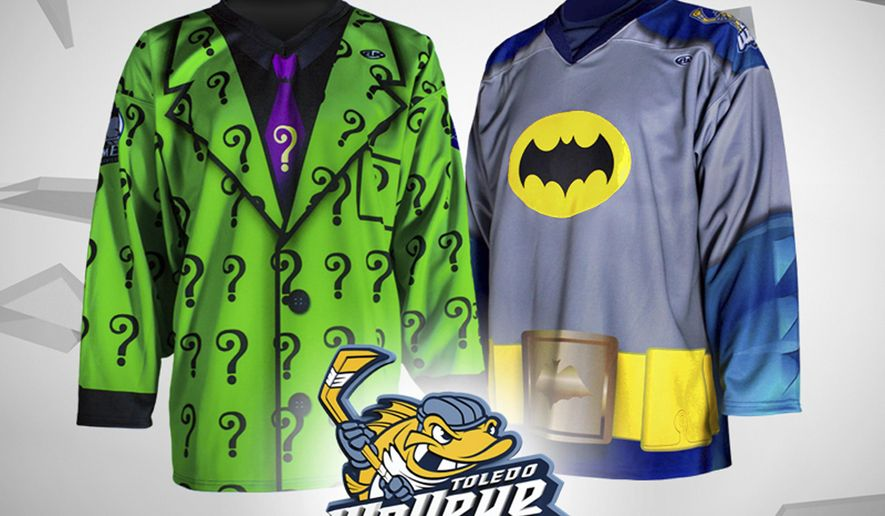 This undated photo provided by the Toledo Walleye Hockey Club shows a batman and  riddler jersey. The Toledo Walleye of the East Coast Hockey League plans to wear Batman jerseys next month against the Evansville IceMen who will be wearing Riddler-themed jerseys. (AP Photo/Toledo Walleye Hockey Club)