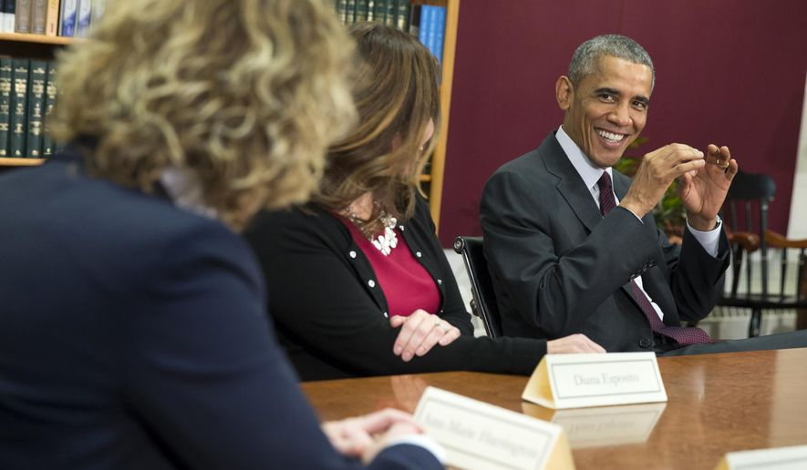 President Barack Obama jokes about Halloween costumes before beginning a roundtable discussion on women's economic issues, Friday, Oct. 31, 2014, at Rhode Island College in Providence, R.I. (AP Photo/Evan Vucci)