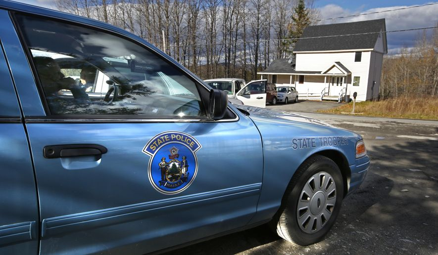 A state trooper is stationed across from the house of nurse Kaci Hickox in Fort Kent, Maine, Thursday, Oct. 30, 2014. State officials are going to court to keep Hickox in quarantine for the remainder of the 21-day incubation period for Ebola that ends on Nov. 10. Police are monitoring her, but can't detain her without a court order signed by a judge.( AP Photo/Robert F. Bukaty)