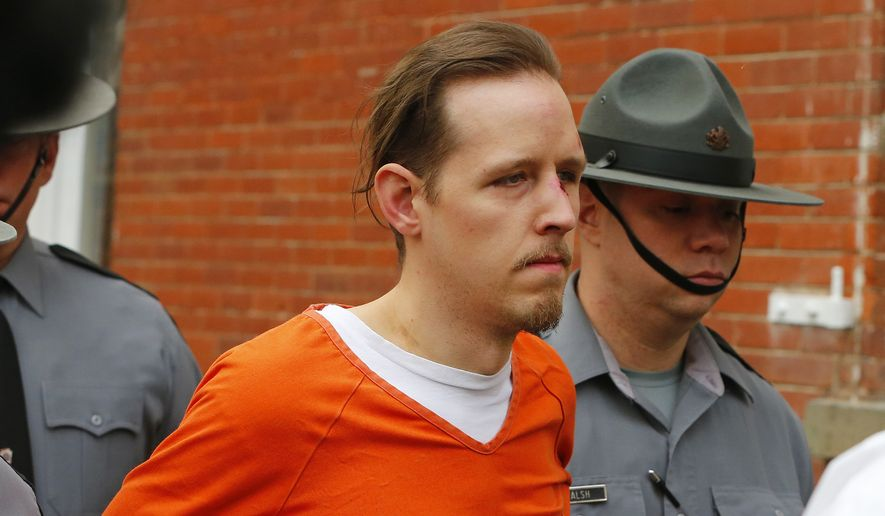 Eric Frein is escorted by police out the Pike County Courthouse after his arraignment in Milford, Pa., Friday Oct. 31, 2014. Frein, was captured seven weeks after police say he killed a Pennsylvania State trooper in an ambush outside a barracks in northeastern Pennsylvania. (AP Photo/Rich Schultz)