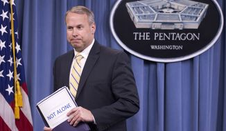 FILE - In this May 1, 2014 file photo, Nate Galbreath, Senior Executive Adviser for the Department of Defense Sexual Assault Prevention and Response Office (SAPRO), leaves a news conference at the Pentagon. Shocked and offended by explicit questions, some U.S. servicemen and women are complaining about a new sexual-assault survey that hundreds of thousands were asked to complete. The survey is conducted every two years, but this year's version, developed by the Rand Corp., includes three pages of questions that detail numerous sexual acts. (AP Photo/Manuel Balce Ceneta, File)