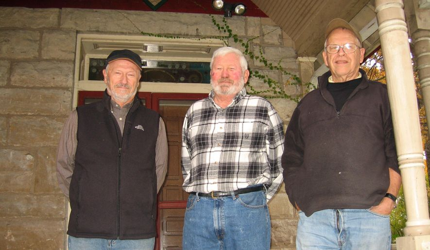 ADVANCE FOR USE SATURDAY, NOV. 1 - In this photo taken on Oct. 23, 2014, from left, local conservationists Steve Brower, Dave Riley and Jerry Rigdon stand on the porch of the boyhood home of Aldo Leopold in Burlington, Iowa. They are in the process of buying the house through the newly created Leopold Landscape Alliance nonprofit group so it can be put to public use. (AP photo/The Hawk Eye, William Smith)