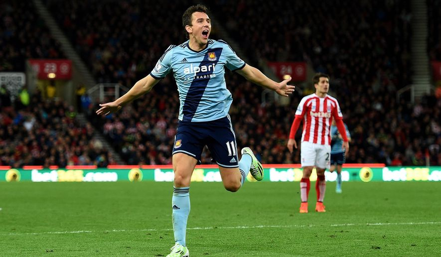 West Ham United's Stewart Downing celebrates scoring his team's second goal against Stoke City, during their English Premier League soccer match at the Britannia Stadium, Stoke, England, Saturday, Nov. 1, 2014. (AP Photo/Martin Rickett, PA Wire)   UNITED KINGDOM OUT     -    NO SALES    -   NO ARCHIVES