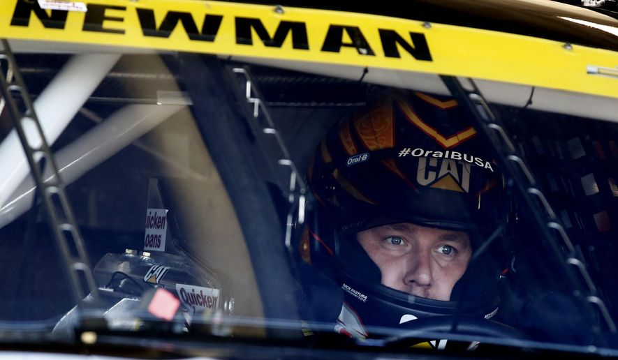 Driver Ryan Newman sits in his car during practice for Sunday's NASCAR Sprint Cup series auto race at the Texas Motor Speedway in Fort Worth, Texas, Saturday, Nov. 1, 2014.  (AP Photo/Jim Cowsert)