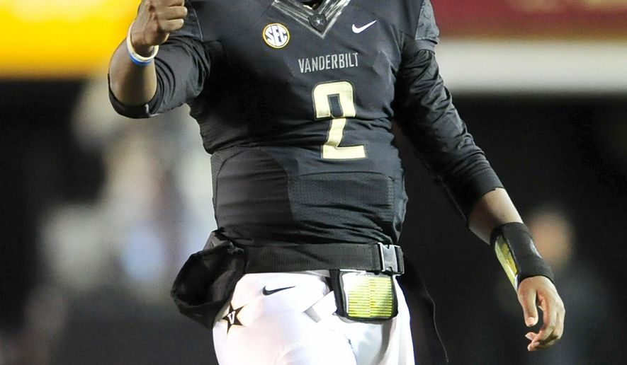 Vanderbilt quarterback Johnny McCrary reacts after he throws a touchdown pass against Old Dominion during the fourth quarter of an NCAA college football game at Vanderbilt Stadium, Saturday, Nov. 1, 2014, in Nashville, Tenn. (AP Photo/The Tennessean, Jae S. Lee)  NO SALES