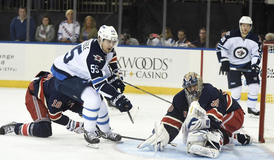 New York Rangers goalie Henrik Lundqvist (30) blocks a shot by Winnipeg Jets center Mark Scheifele (55) during the first period of an NHL hockey game at Madison Square Garden on Saturday, Nov. 1, 2014, in New York. (AP Photo/Kathy Kmonicek)