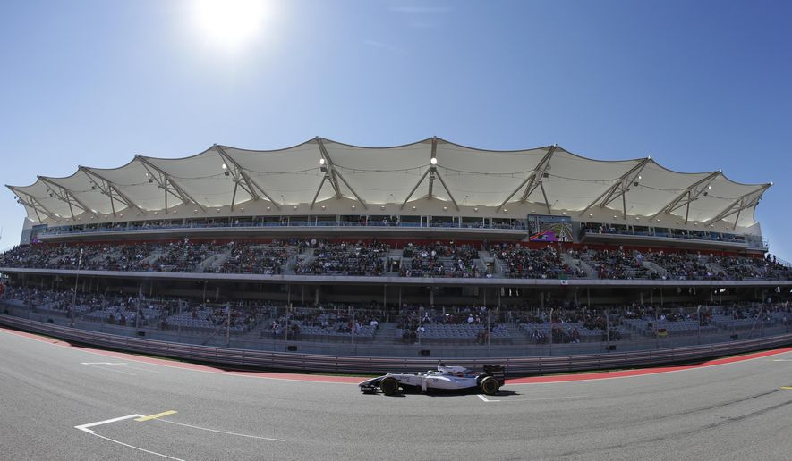 Williams driver Felipe Massa, of Brazil, makes his way past the grand stand during qualifying for the Formula One U.S. Grand Prix auto race at the Circuit of the Americas, Saturday, Nov. 1, 2014, in Austin, Texas. (AP Photo/Darron Cummings)