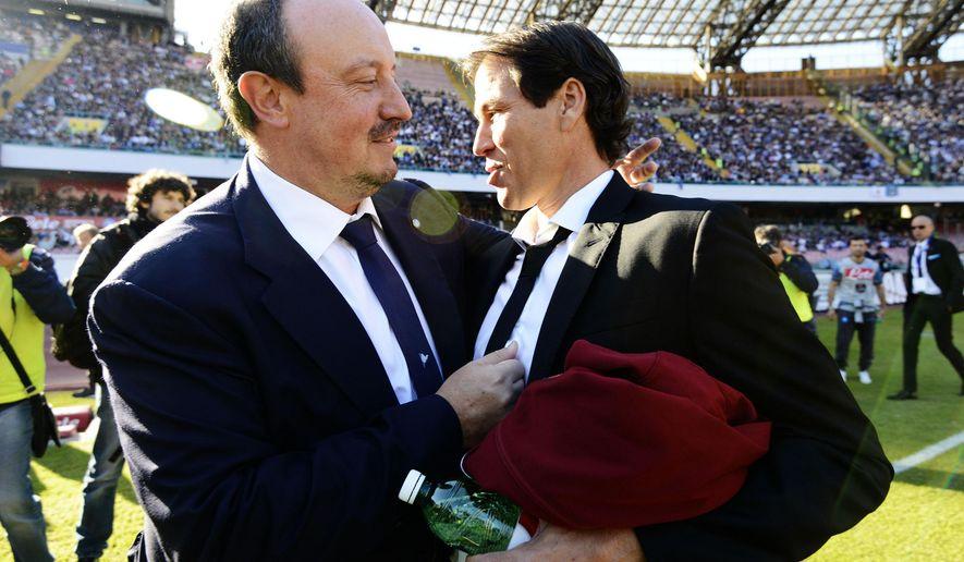 Napoli coach Rafa Benitez, left, and Roma coach Rudi Garcia greet each other prior to a Serie A soccer match between Napoli and Roma at the Naples San Paolo stadium, Saturday, Nov. 1, 2014. (AP Photo/Gennaro Giorgio)