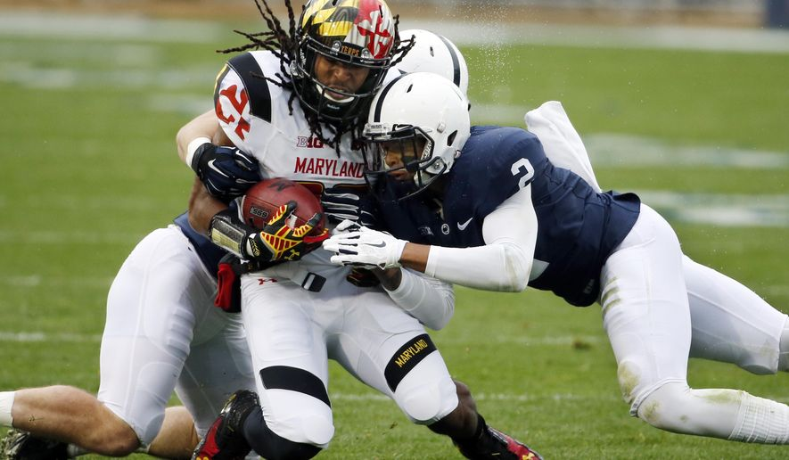 Maryland wide receiver Marcus Leak (82) is tackled by Penn State safety Marcus Allen (2) and linebacker Mike Hull, rear, during the first half of an NCAA college football game in State College, Pa., Saturday, Nov. 1, 2014. (AP Photo/Gene J. Puskar)