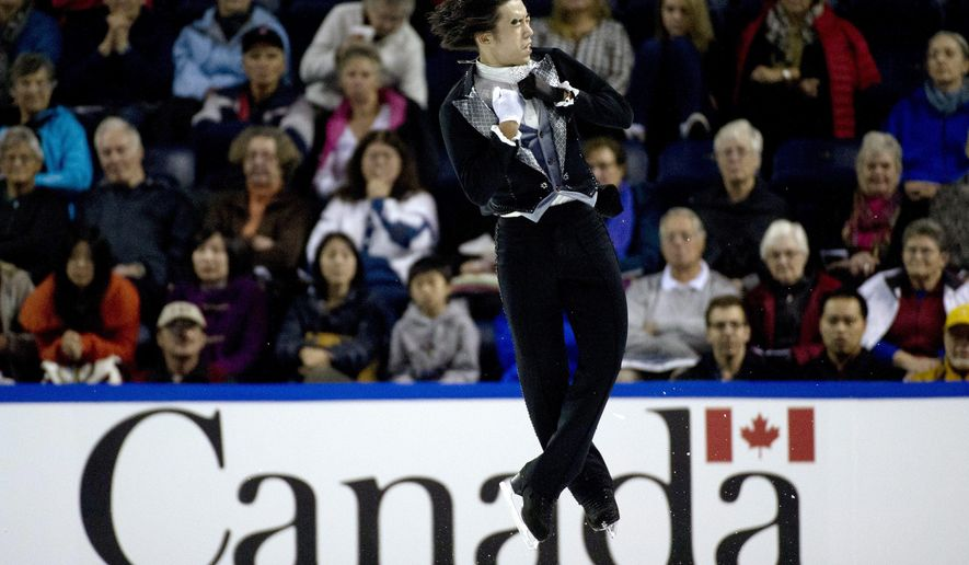 Takahito Mura, of Japan, performs during the men's free skate program at the Skate Canada International figure skating event in Kelowna, British Columbia, Saturday, Nov. 1, 2014. (AP Photo/The Canadian Press, Jonathan Hayward)