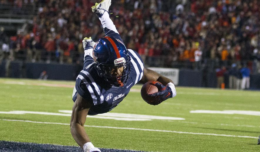 Mississippi running back I'Tavius Mathers dives in for a touchdown against Auburn during the first half of an NCAA college football game Saturday, Nov. 1, 2014, in Oxford, Miss. (AP Photo/Brynn Anderson)
