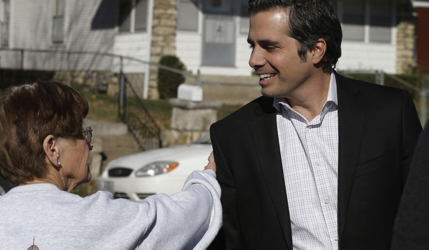 Independent senate candidate Greg Orman, right, talks with a supporter before a campaign event in Kansas City, Kan., Friday, Oct. 31, 2014. (AP Photo/Orlin Wagner)