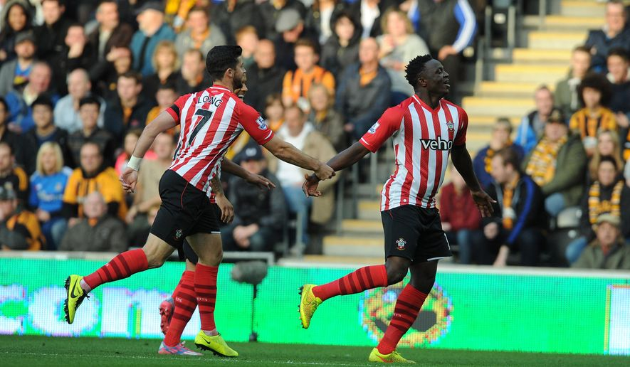 Southampton's Victor Wanyama, right, celebrates after scoring his side's first goal during the English Premier League match at the KC Stadium, Hull, England, Saturday Nov. 1, 2014. (AP Photo/PA, Anna Gowthorpe) UNITED KINGDOM OUT  NO SALES  NO ARCHIVE