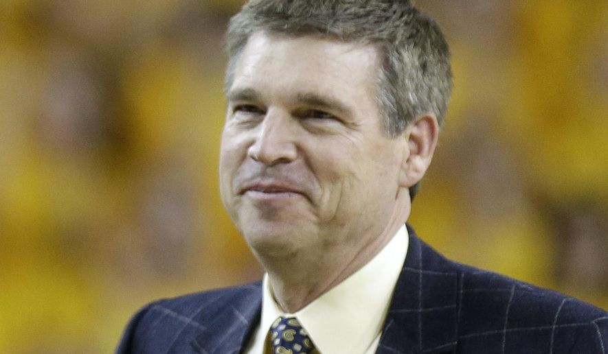 In this Feb. 17, 2013, file photo, Michigan athletic director Dave Brandon is shown during a basketball game between Michigan and Penn State at Crisler Center in Ann Arbor, Mich. Brandon has resigned, setting the stage for new leadership at the top of one of the nation's most prominent athletic departments. (AP Photo/Carlos Osorio, File)