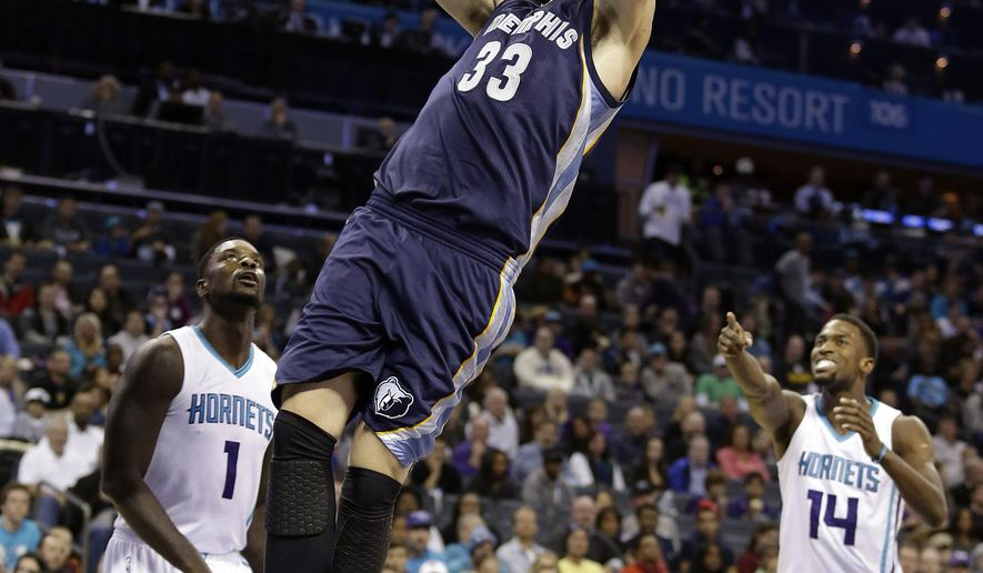 Memphis Grizzlies' Marc Gasol (33) dunks as Charlotte Hornets' Lance Stephenson (1) and Michael Kidd-Gilchrist (14) stand near during the first half of an NBA basketball game in Charlotte, N.C., Saturday, Nov. 1, 2014. (AP Photo/Bob Leverone)