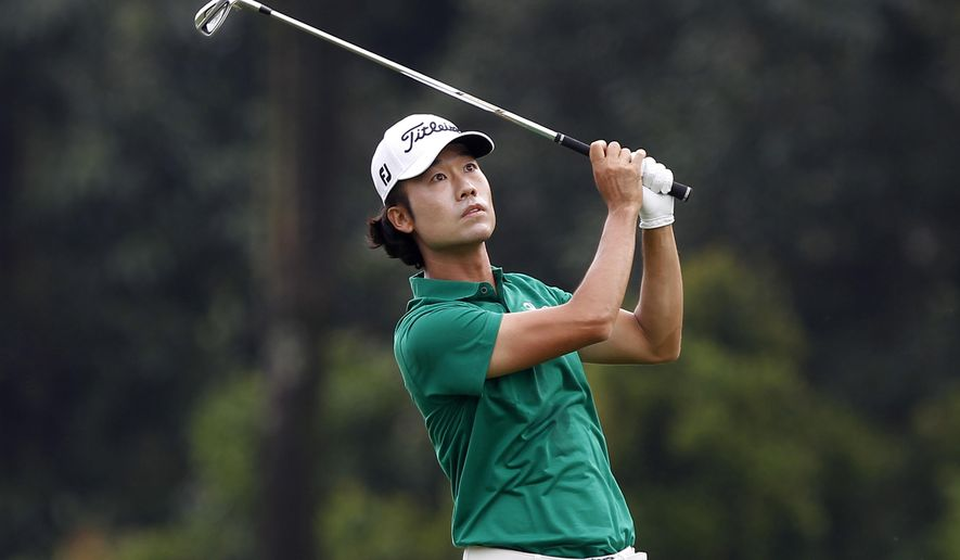 Kevin Na of the United States watches his shot on the 1st hole during the third round of the CIMB Classic golf tournament at the Kuala Lumpur Golf and Country Club in Kuala Lumpur, Malaysia, Saturday, Nov. 1, 2014. (AP Photo/Lai Seng Sin)