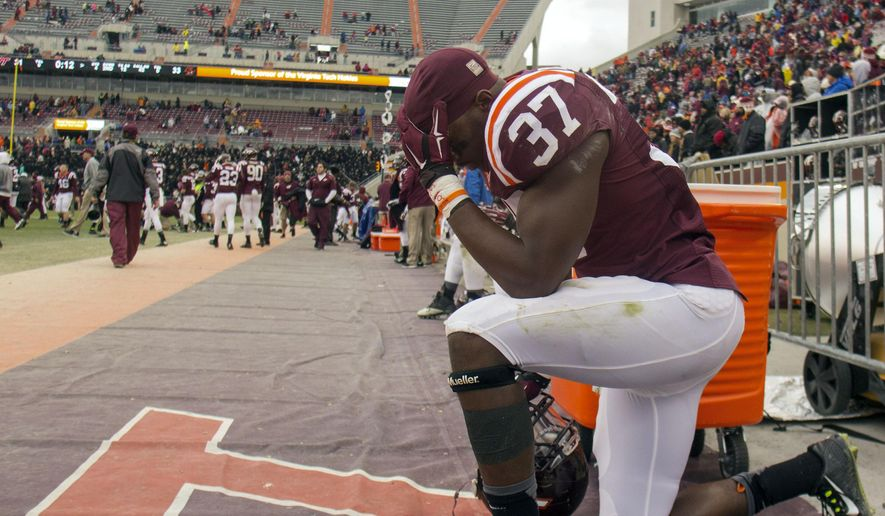 Virginia Tech outside linebacker Ronny Vandyke (37) reacts after losing 33-31 to Boston College in an NCAA college football game, Saturday, Nov. 1, 2014, in Blacksburg Va. (AP Photo/The Roanoke Times, Shaban Athuman)  LOCAL TELEVISION OUT; SALEM TIMES REGISTER OUT; FINCASTLE HERALD OUT;  CHRISTIANBURG NEWS MESSENGER OUT; RADFORD NEWS JOURNAL OUT; ROANOKE STAR SENTINEL OUT