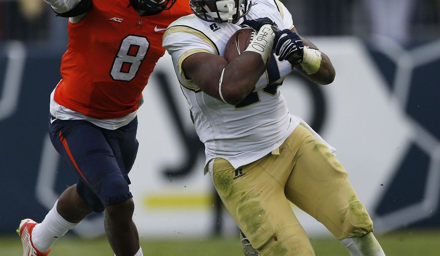Georgia Tech running back Synjyn Days (10) runs against Virginia safety Anthony Harris (8) during the first half of an NCAA college football game, Saturday, Nov. 1, 2014, in Atlanta. (AP Photo/Mike Stewart)