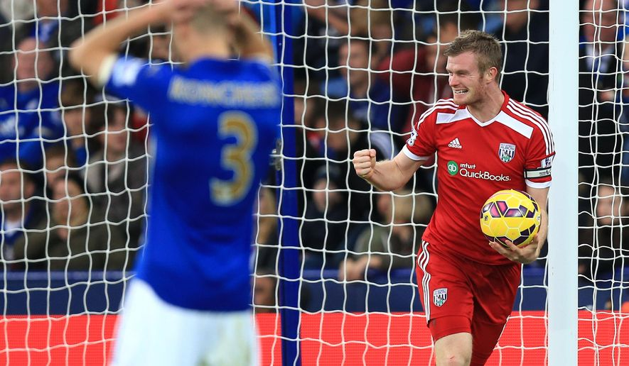 West Bromwich Albion's Chris Brunt celebrates after Leicester City's Esteban Cambiasso (not pictured) scored an own goal during their English Premier League soccer match at the King Power Stadium, Leicester, England, Saturday, Nov. 1, 2014. (AP Photo/Mike Egerton, PA Wire)     UNITED KINGDOM OUT     -   NO SALES    -   NO ARCHIVES