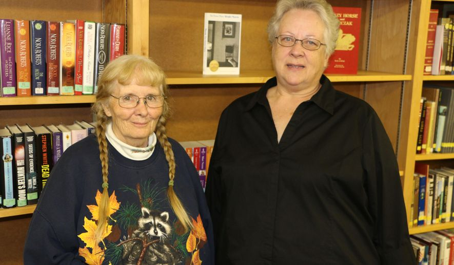 In this Oct. 27, 2014 photo, Juanita Baker, left, and Francie Warren stand for a photo, the two are part of a group taking on a project to preserve the history of Minatare, Neb., and the surrounding areas. (AP Photo/The Star-Herald, Bart Schaneman)