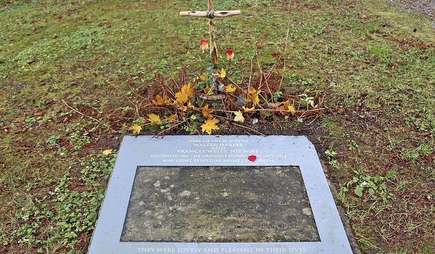 ADVANCE FOR USE SUNDAY, NOV. 1 - This photo taken on Oct. 25, 2014, shows the joint gravesite marker of Walter Harper and Frances Wells, who both died during the Oct. 25, 1918 sinking of the steamship Princess Sophia, at Evergreen Cemetery in Juneau, Alaska. A short ceremony, which has been held for at least 20 years, took place on the 96th anniversary of the Princess Sophia's wreck at the joint gravesite of Harper and Wells, newlyweds who were among the 343 victims of the disaster, the worst maritime accident in Alaska history. (AP Photo/Juneau Empire, Amy Fletcher)