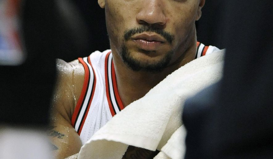 Chicago Bulls' Derrick Rose sits on the bench during the second half of an NBA basketball game against the Cleveland Cavaliers in Chicago, Friday, Oct. 31, 2014. Cleveland won 114-108 in overtime. (AP Photo/Paul Beaty)