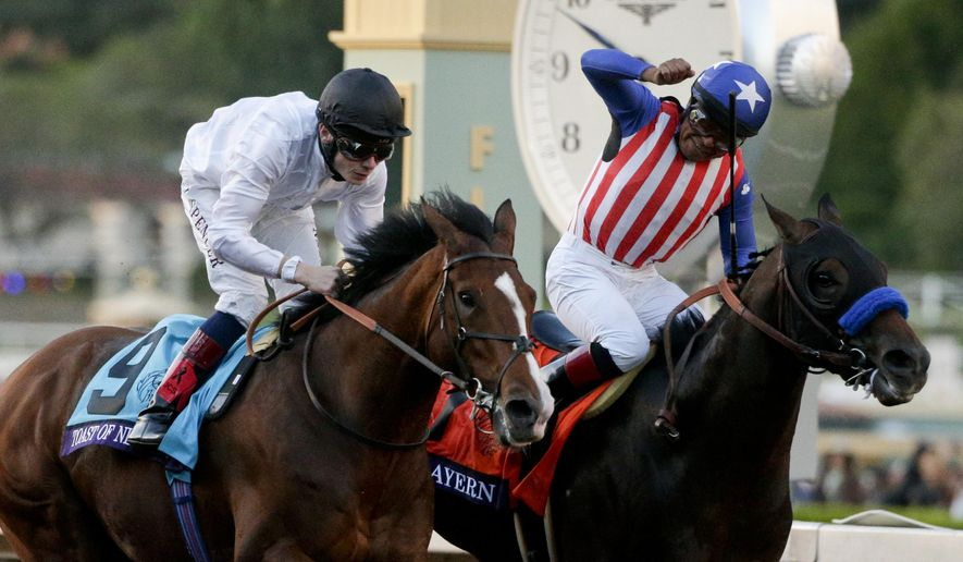 Jockey Martin Garcia celebrates after riding Bayern, right, to victory in the Breeders' Cup Classic horse race past jockey Jamie Spencer on Toast of New York at Santa Anita Park, Saturday, Nov. 1, 2014, in Arcadia, Calif. (AP Photo/Jae C. Hong)