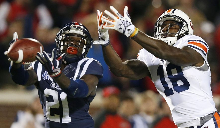 Auburn wide receiver Sammie Coates (18) can't catch a pass against Mississippi defensive back Senquez Golson (21) during the first half of an NCAA college football game, Saturday, Nov. 1, 2014, in Oxford, Miss. (AP Photo/Brynn Anderson)