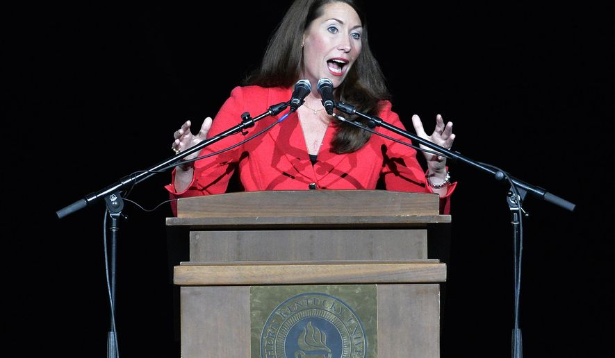 Kentucky Democrat Senate candidate Alison Lundergan Grimes addresses a group of supporters during a rally in Highland Heights, Ky., Saturday, Nov. 1, 2014.   Lundergan faces Republican Sen. Mitch McConnell in the general election on Nov. 4, 2014.  (AP Photo/Timothy D. Easley)