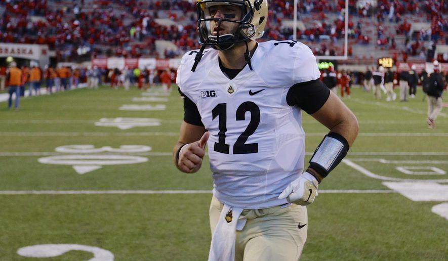 Purdue quarterback Austin Appleby (12) runs off the field following an NCAA college football game against Nebraska in Lincoln, Neb., Saturday, Nov. 1, 2014. Nebraska won 45-14. (AP Photo/Nati Harnik)