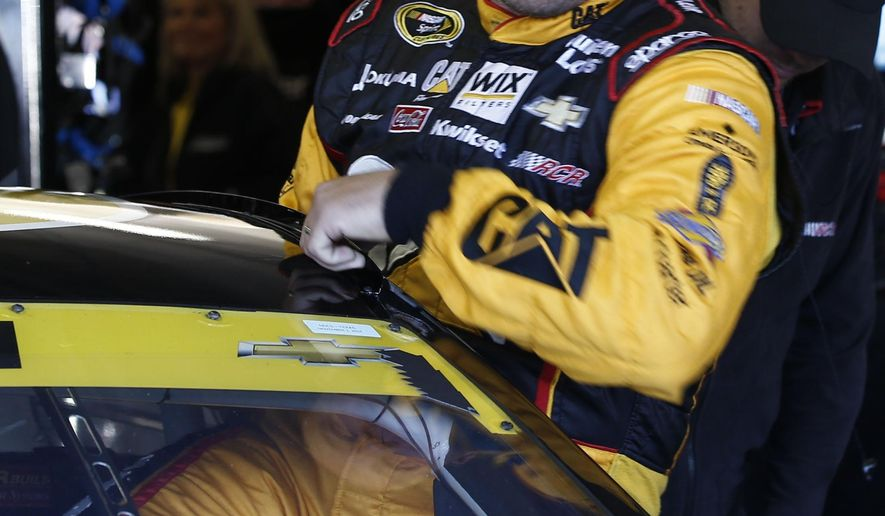 Driver Ryan Newman climbs into his car during practice for Sunday's NASCAR Sprint Cup series auto race at the Texas Motor Speedway in Fort Worth, Texas, Saturday, Nov. 1, 2014.  (AP Photo/Jim Cowsert)