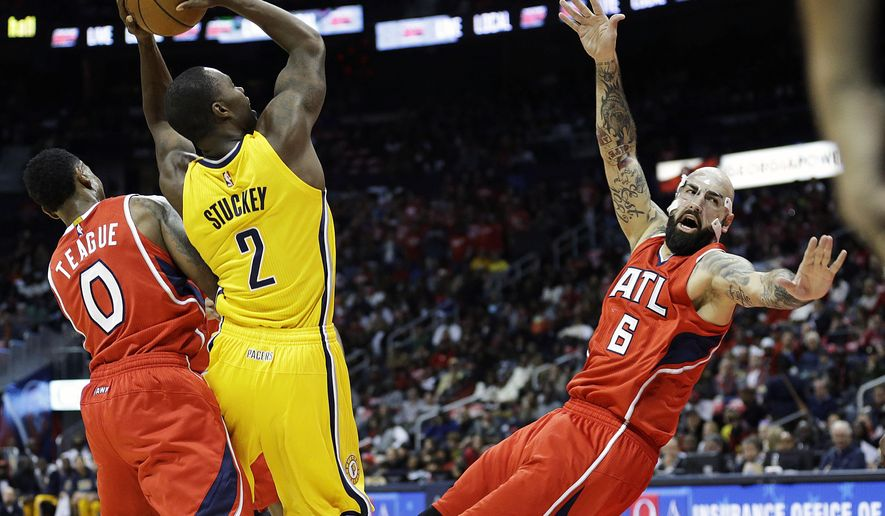 Atlanta Hawks' Pero Antic, right, of Macedonia, falls to the floor as Indiana Pacers guard Rodney Stuckey (2) is called for charging in the first quarter of an NBA basketball game, Saturday, Nov. 1, 2014, in Atlanta. (AP Photo/David Goldman)