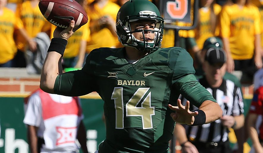 Baylor quarterback Bryce Petty (14) drops back to pass against Kansas  in the first half of an NCAA college football game, Saturday, Nov. 1, 2014, in Waco, Texas. (AP Photo/ Jerry Larson)