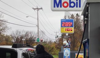 A customer pumps gas in Pittsfield, Mass., where gas prices have fallen below $3 per gallon, Saturday, Nov. 1, 2014. A gallon of regular gas at the station was going for $2.89. (AP Photo/Barbara Woike)