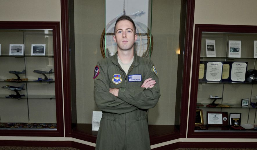 This Oct. 23, 2014 photo provided by the US Air Force shows 2nd Lt. Joshua Nelson as he poses for a portrait at the 47th Flying Training Wing headquarters at Laughlin Air Force Base, near Del Rio, Texas. State Delegate Josh Nelson has missed almost every legislative meeting and vote in his first term. Nelson has been in Texas for pilot training with the National Guard almost all of his two years as a lawmaker and is fighting to retain his seat.  (AP Photo/U.S. Air Force, Staff Sgt. Steven R. Doty)